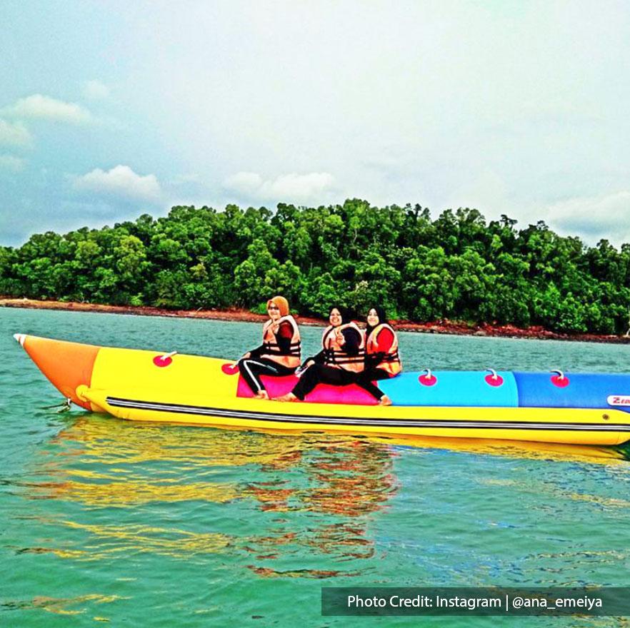Fun banana boat rides in Teluk Kemang Beach Port Dickson