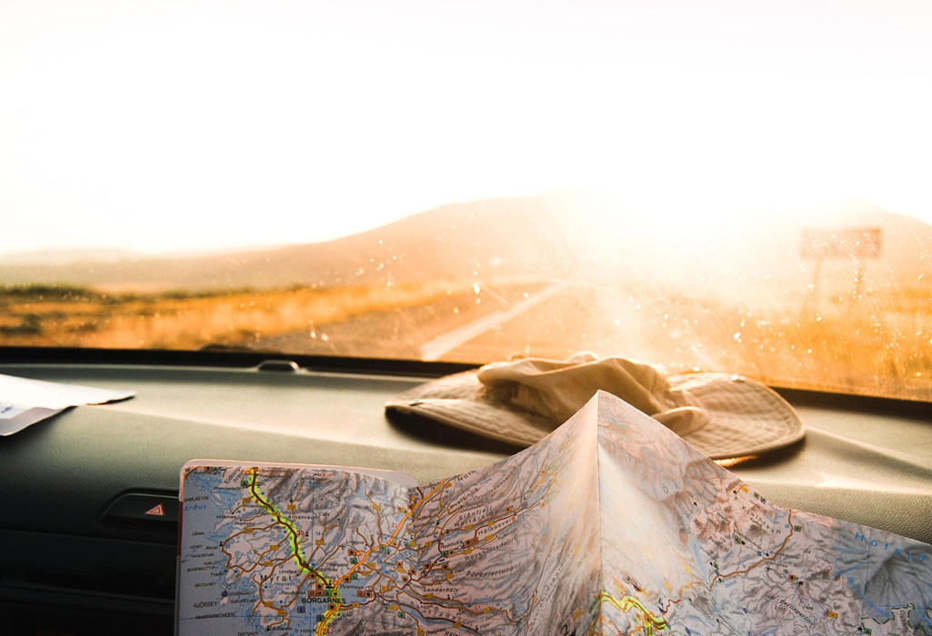 map on a dashboard with the sun in the background