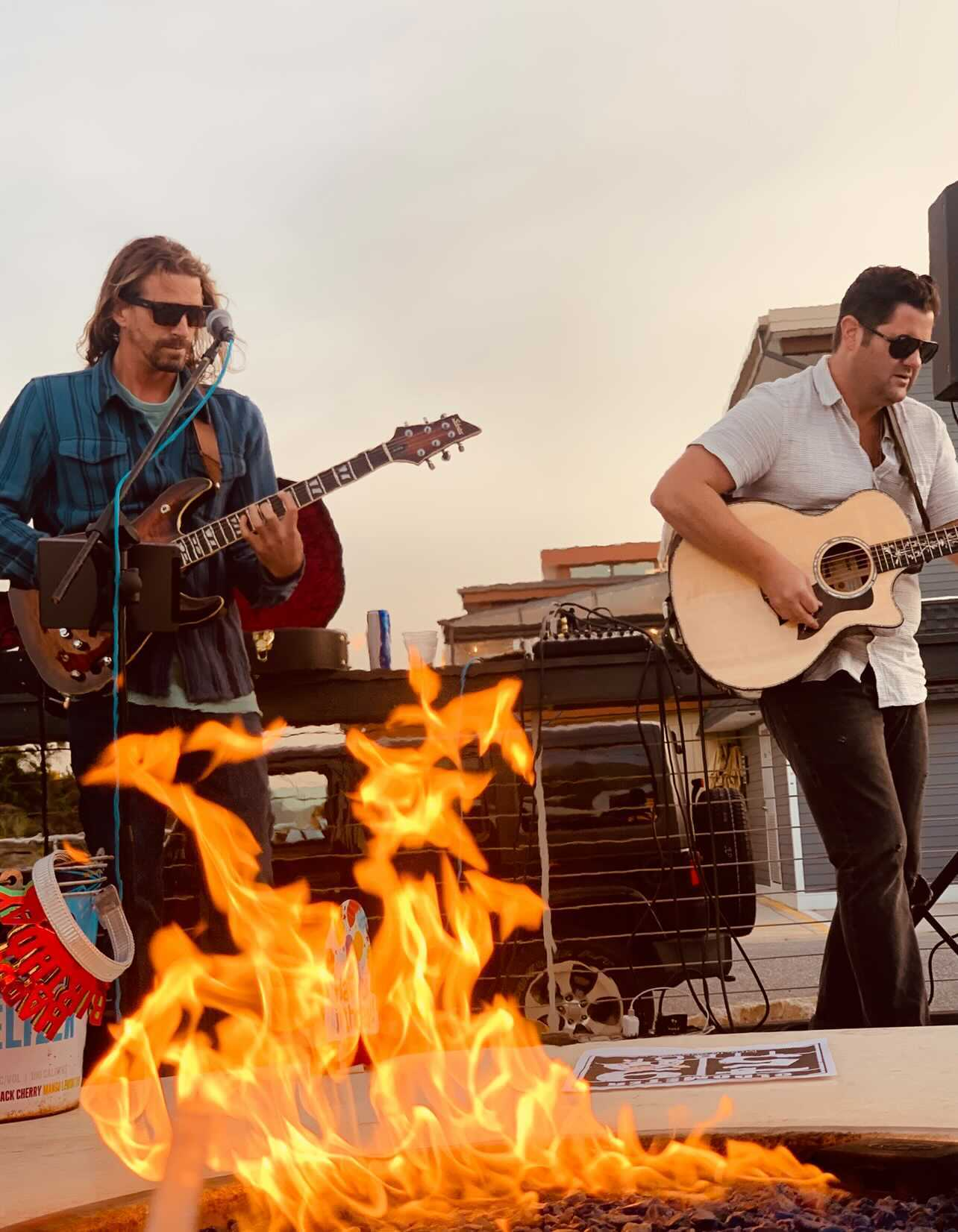 Black Dandelion Band playing at ICONA Avalon's Sandbar Village with Fire Pit in front of them