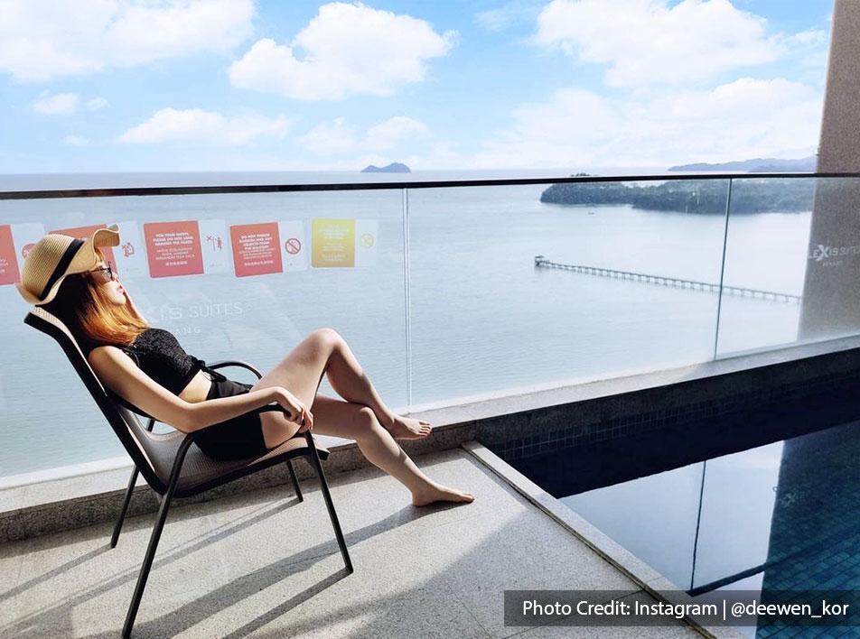 Woman enjoying private pool at Lexis Suites Penang