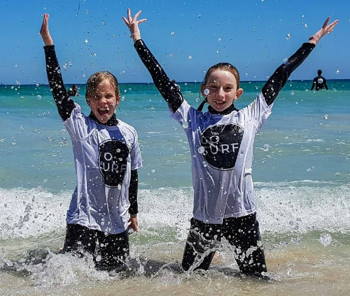 https://www.gosurfperth.com/kids-group-surf-course#school-holiday-surfing-lessons-perth-section