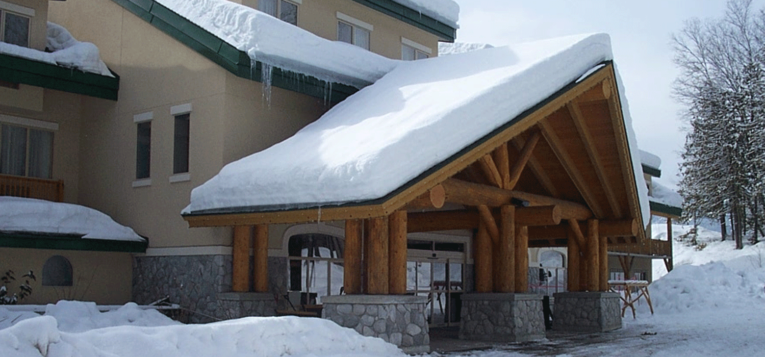 exterior of Coast Hillcrest Hotel with snow