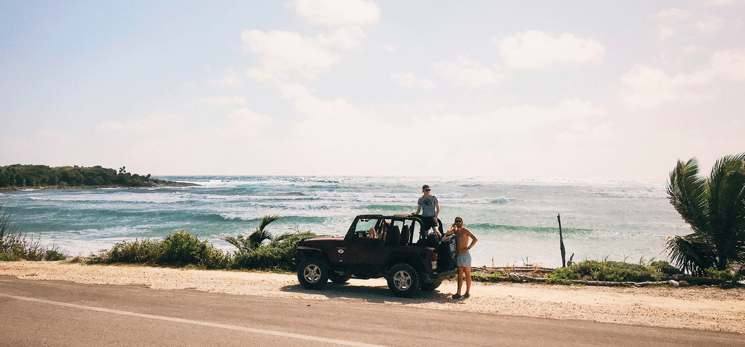 Jeep parked by ocean on a road trip