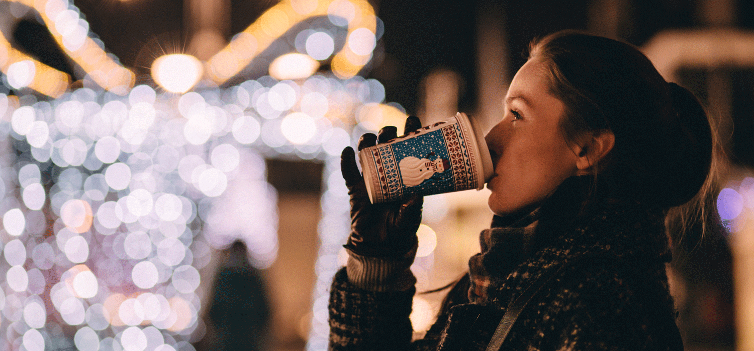 woman drinking hot chocolate at christmas