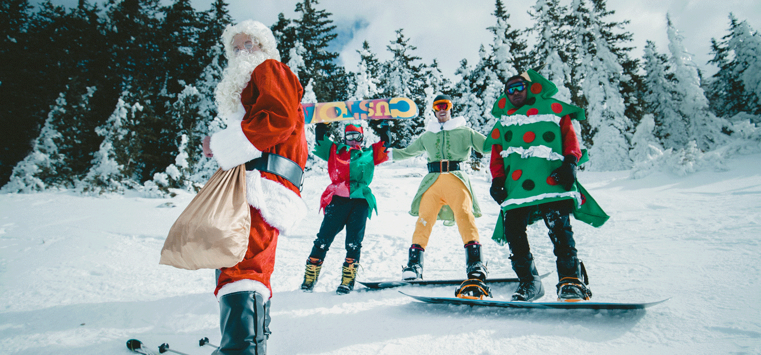 santa on a snowboard with characters behind him