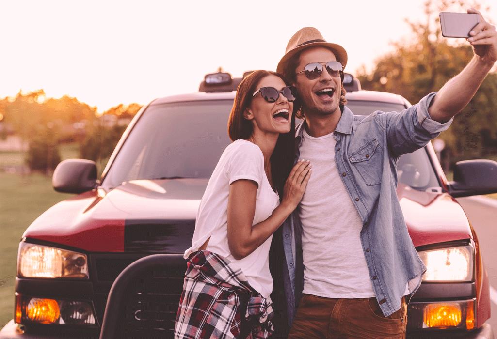 couple taking a selfie on a roadtrip